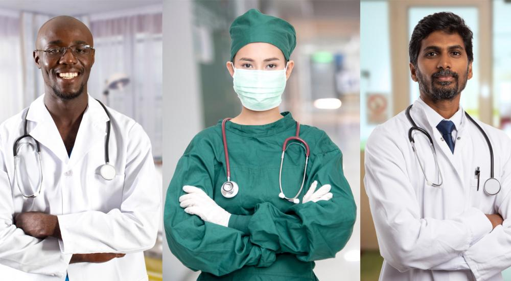 three doctors in scrubs and white coats
