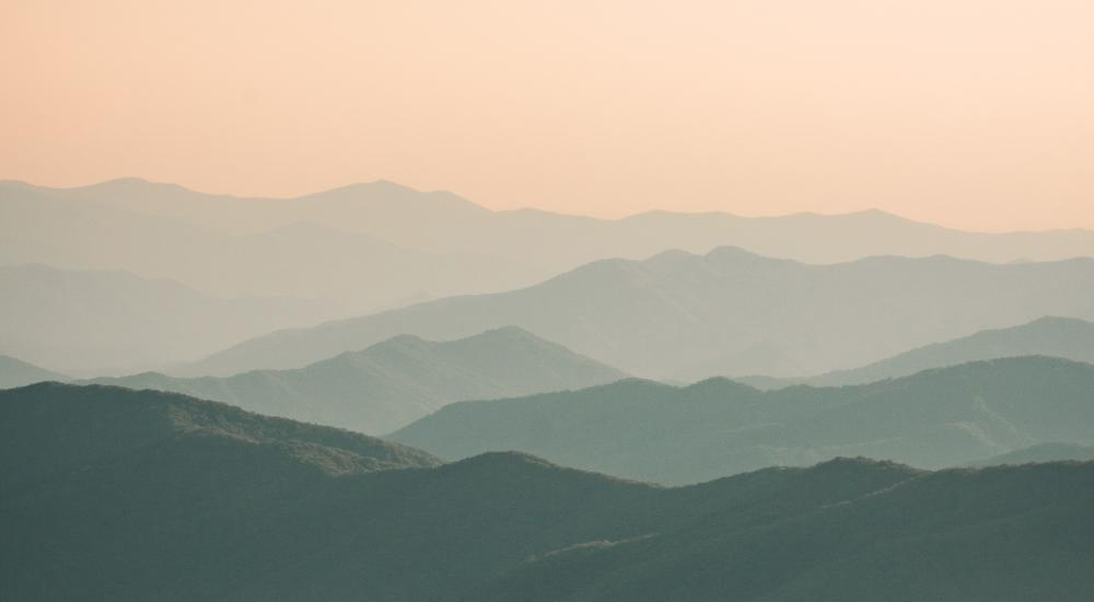 Mountain ranges in different shades