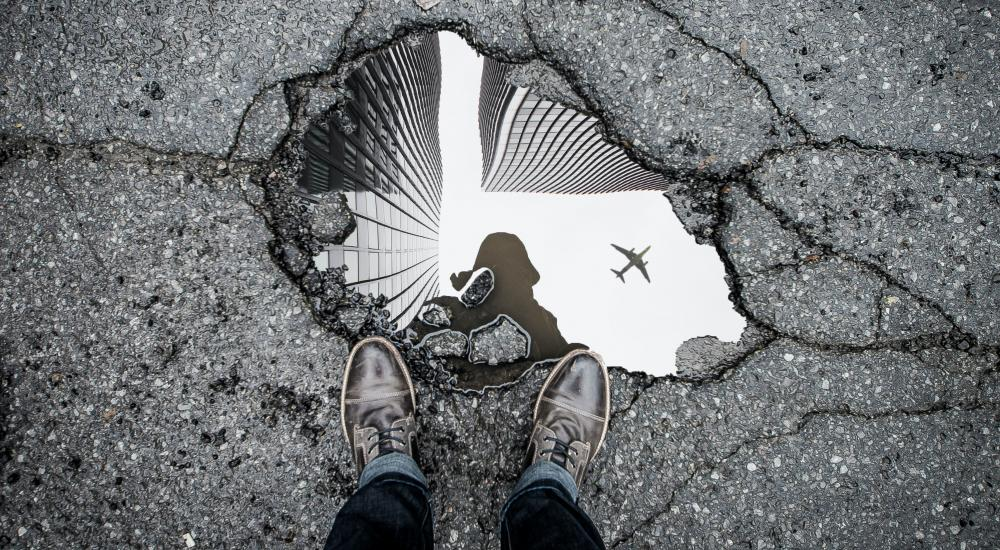Reflection of a plane in a puddle