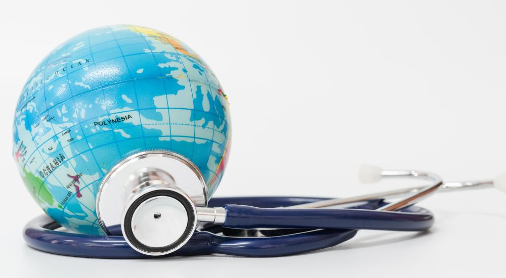 a globe with a stethoscope next to it