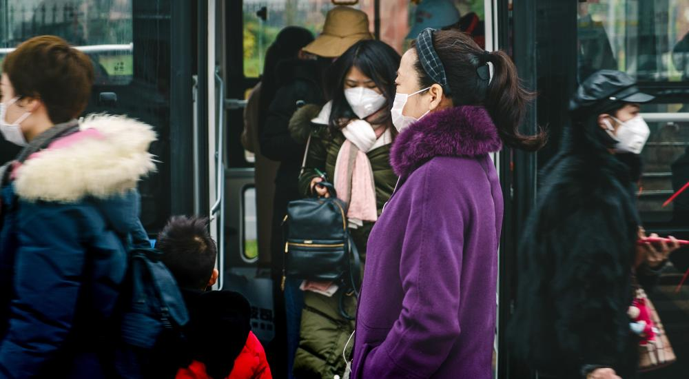 People in China wearing surgical masks