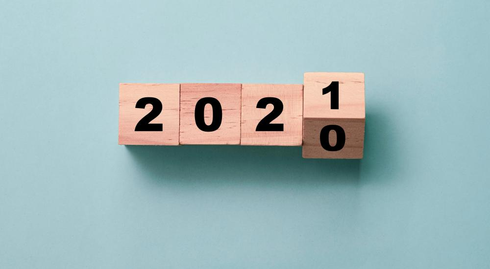 wooden blocks on a blue background turning from 2020 to 2021