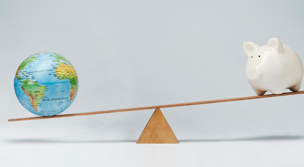globe and piggy bank balancing