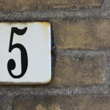 The number five on an address placard