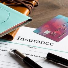 travel documents and insurance forms on a desk